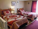 Two guests can sleep comfortably in this bedroom's twin-sized beds.