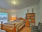 The second bedroom offers a cozy queen bed.