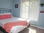 Another guest room with queen bed.