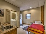 Additional sleeping is available on a twin bed and sleeper sofa.