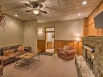 Downstairs is a cozy living area with a flat-screen Smart TV & gas fireplace.