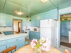 The bright blue kitchen is fully equipped.