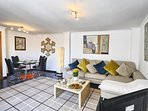 Spacious bright living/dining area. Heating, air-con etc