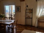 Extending dining table and 6 chairs with more seating on the terrace