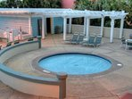 Hot tub located on the pool deck with beautiful ocean views
