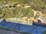 Onsite tennis court near the putt putt golf course