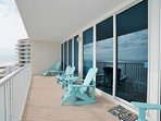 Private balcony with Adirondack chair seating