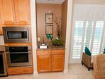 Wet bar next to built-in oven and microwave