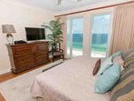 Master bedroom with views of beach and Gulf