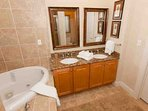 Ensuite bath with dual vanities and whirlpool tub