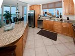 Kitchen with tile floor, stainless steel appliances and granite counters