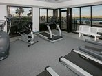 Fitness center overlooking pool area