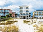 Photo taken from beach. Direct gulf front home  which offers amazing views down the beach.
