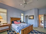 Dream easily in the second bedroom with a queen-sized bed.