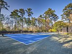 The villa offers access to numerous community amenities, including tennis courts.