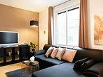 L-shaped sofa 47inch TV + Apple TV