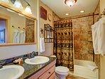 Full hall bathroom with 2 sinks