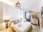 First floor: bedroom with door window and French balcony