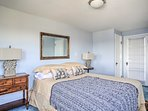 The master bedroom boasts a queen bed and spacious sitting room.