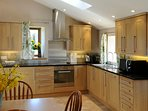 The breakfasting kitchen with electric hob, oven, dishwasher and American style fridge freezer