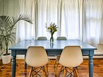 This adorable blue dining table is complemented by mid-century modern chairs.