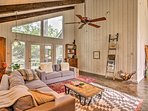 Exposed beams and natural woodwork help to maintain the home's 1970s roots.
