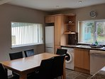 Large full fitted dining kitchen at the rear with door leading out to shared drying green
