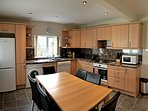 Fully equipped dining kitchen with fridge freezer, washing machine and dishwasher