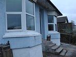 house now blue after external wall insulation