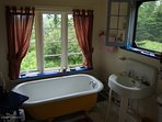 Claw tub bath looks out at Mt. Ascutney. Outdoor h/c shower too.
