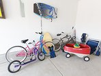 Find 2 bikes, a kids wagon and beach gear in the garage