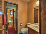 The jack-and-jill bathroom features a shower/tub combo.
