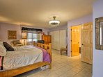 The master bedroom has a sumptuous king bed.