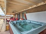 Relax in the private hot tub after a day on the trails.