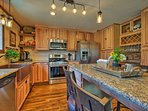 Maple cabinets and granite countertops highlight the fully equipped kitchen.