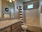 A traditional shower/tub combo is provided in this second full bathroom.