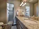 Enjoy a rinse in the full en-suite bathroom with a walk-in shower.