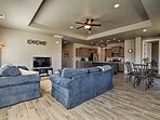 Tiered ceilings enhance a modern ambiance to the spacious living room.