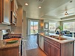 Granite countertops complement the stainless steel appliances.