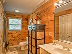This spacious bathroom is the perfect place to freshen up.