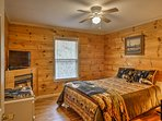 This master bedroom offers a queen bed and flat-screen TV.