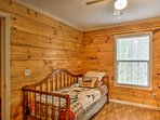 This bedroom offers a cozy twin bed and twin trundle bed.