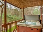 This home boasts a hot tub, fire pit, and a large porch.