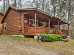 Escape to Ellijay at this rustic 2-bedroom, 1-bathroom vacation rental cabin.
