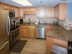 Fully equipped kitchen with granite counters and tile backsplash