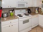 Kitchen with all appliances, toaster, coffee pot