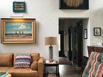 A Native American Ceremonial Skirt, Roger Iker painting and one of my weavings adorn the living area