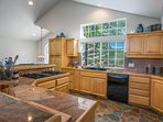 Enjoy a view of the pines while you prepare a meal in the full kitchen.