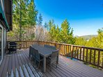 You'll find a gas grill and outdoor dining for 8 on the deck.