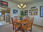 Gather around the 4-person dining table to enjoy meals.